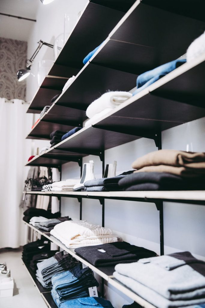 clothes folded on shelves