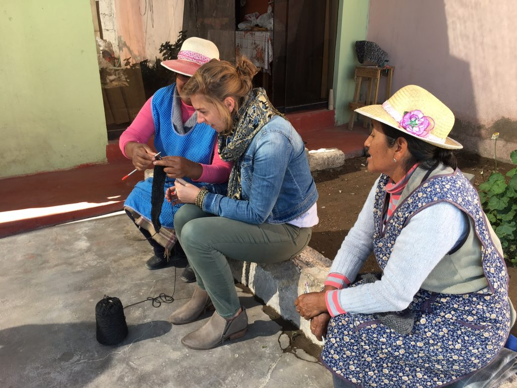 Brianna working with two women in peru